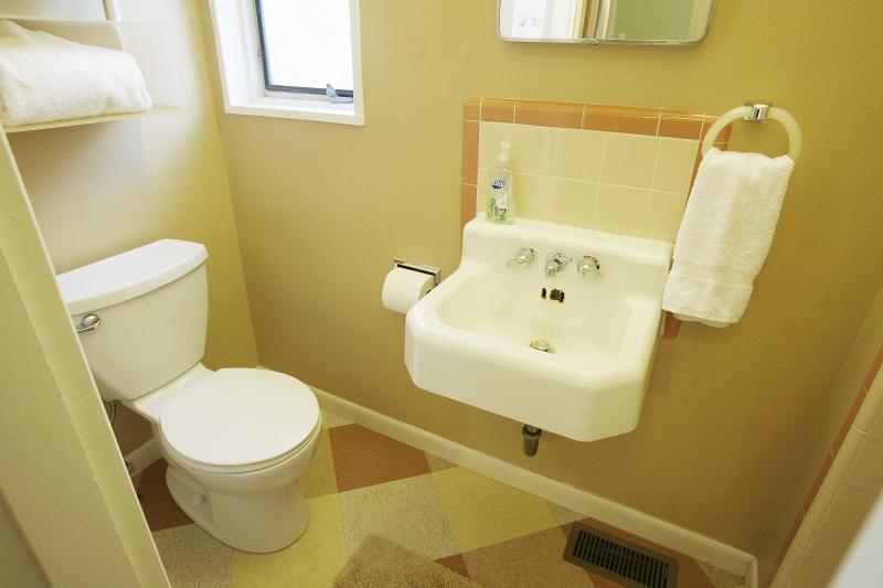 3/4 bath off third bedroom/media room