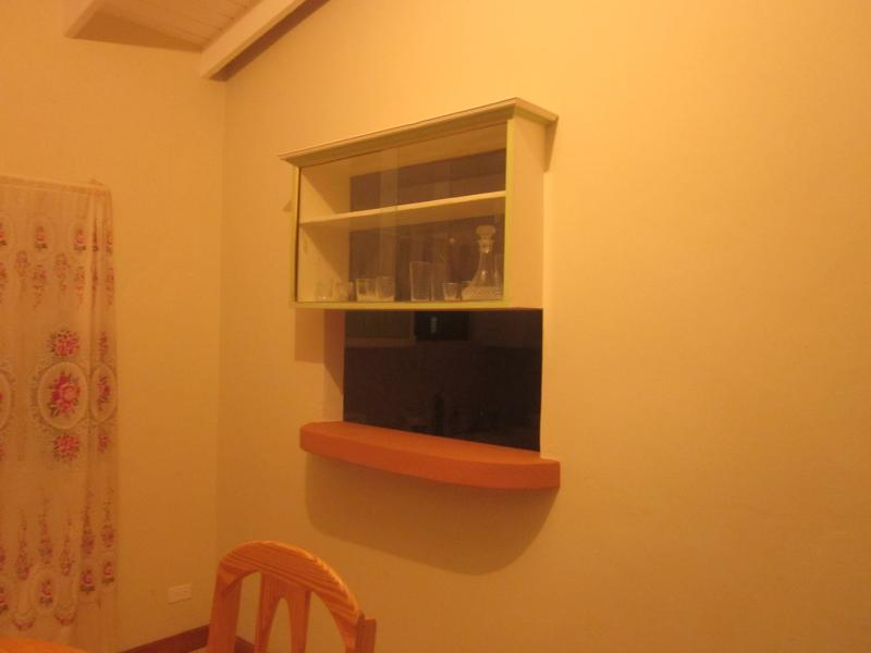 A two way bar cabinet