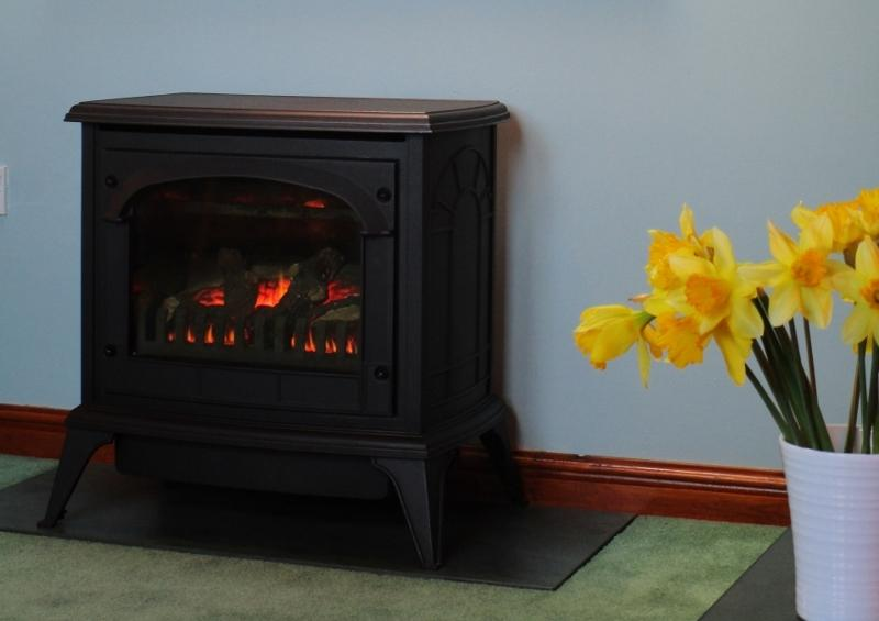 Our featured cast iron gas fire sits on slate and will warm you on those cosy evenings at home