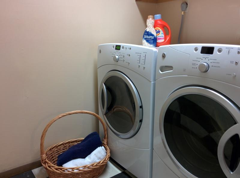 Fully stocked laundry room.