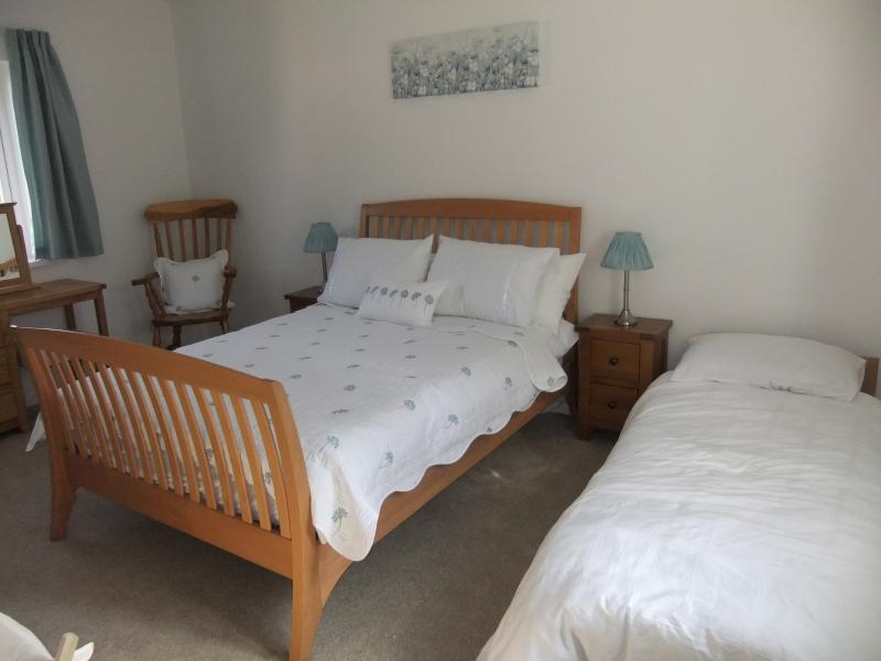 A single bed can be placed in bedroom 1 on request
