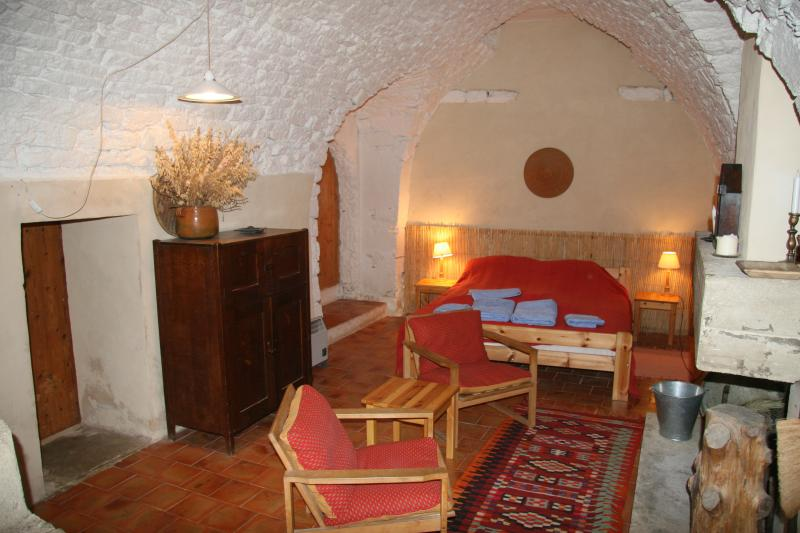 The thick walls keep the bedroom cool, king size bed, with sitting area and open fire for the winter
