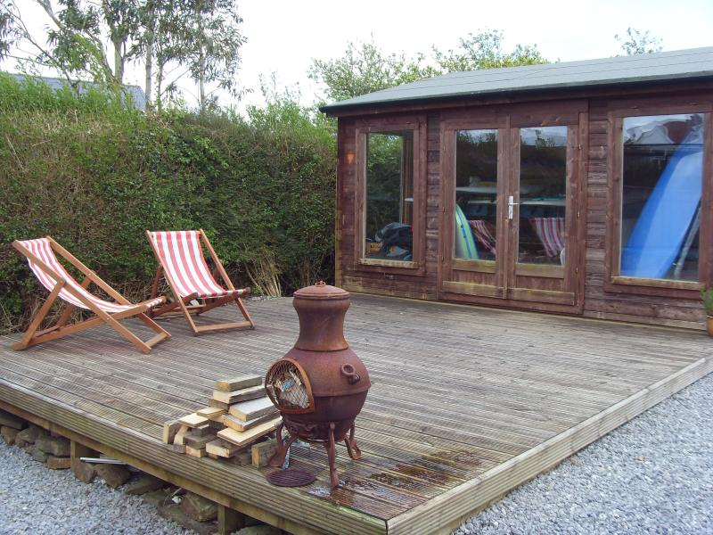 Log cabin with hot tub and decking area