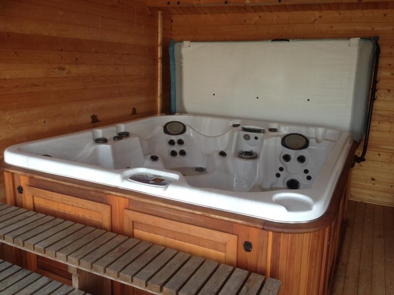 hot tub in enclosed log cabin