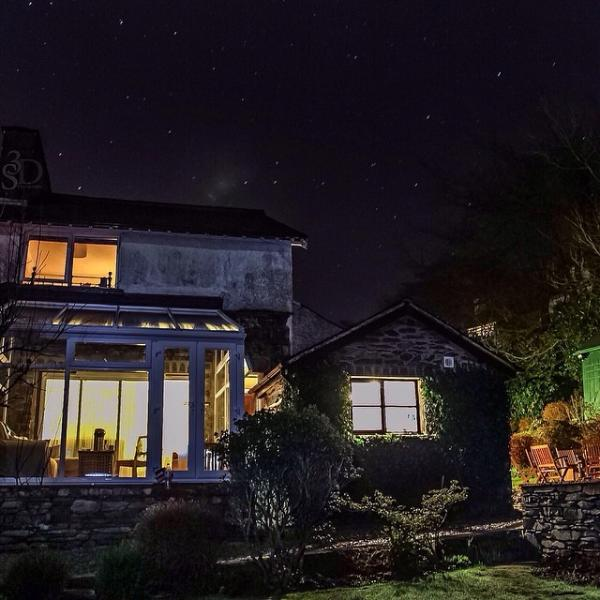 Rear of cottage at night, twinkling stars