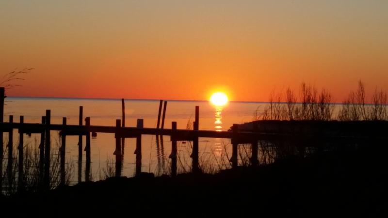 Sunrise over Neighbor's pier