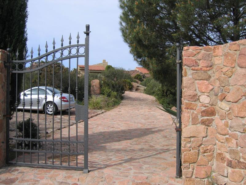 The entrance gate with inside parking