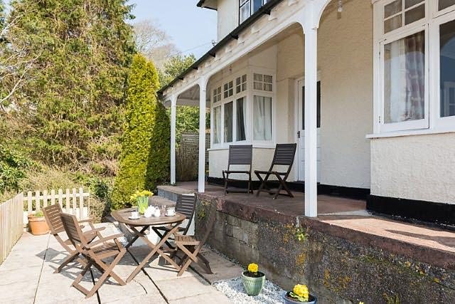 Haven House -perfect spot on the patio to sit and relax and enjoy the views