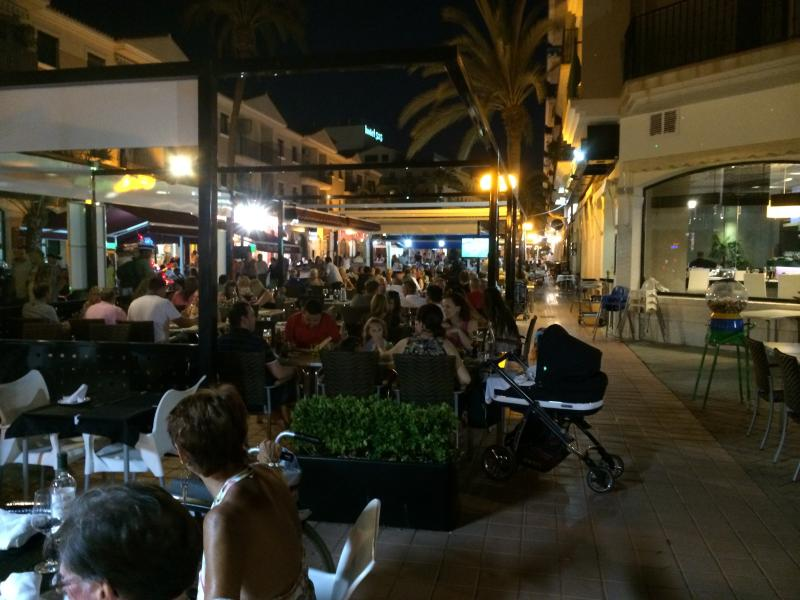 the square at night. lively!