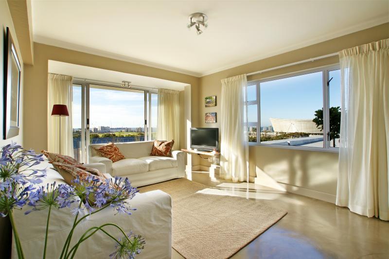 Livingroom. Sliding doors open onto a narrow Juliette balcony