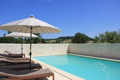 stone walls provide privacy to south facing private  pool