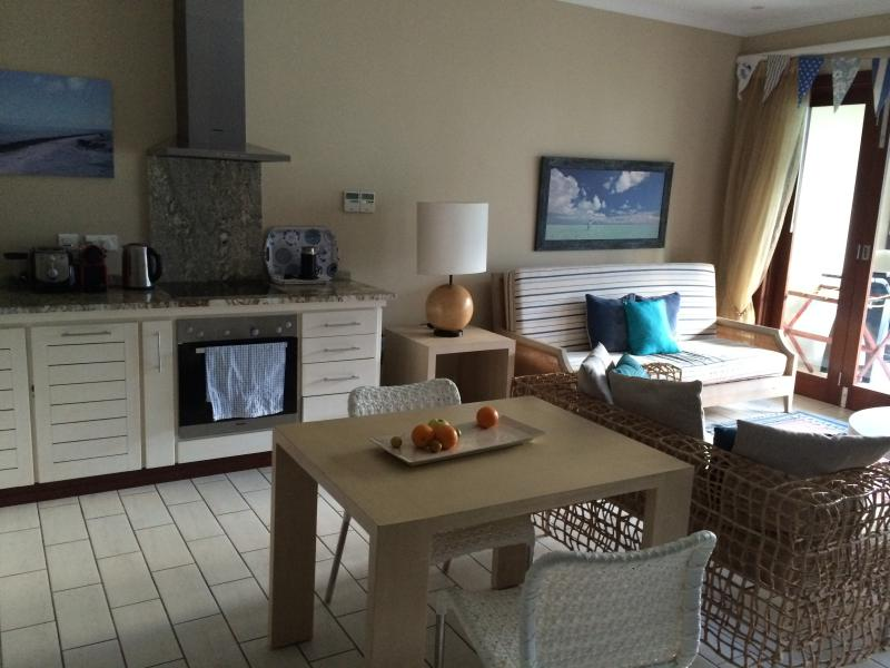 The apartment is spacious and modern with breathtaking views of the ocean.