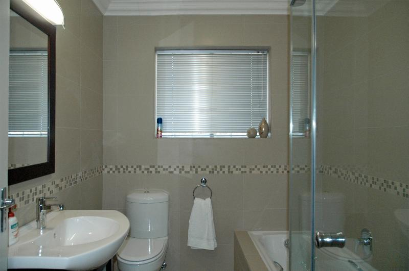 Modern bathroom with toilet, bath, shower, basin and heated towl rail for warm fluffy towels
