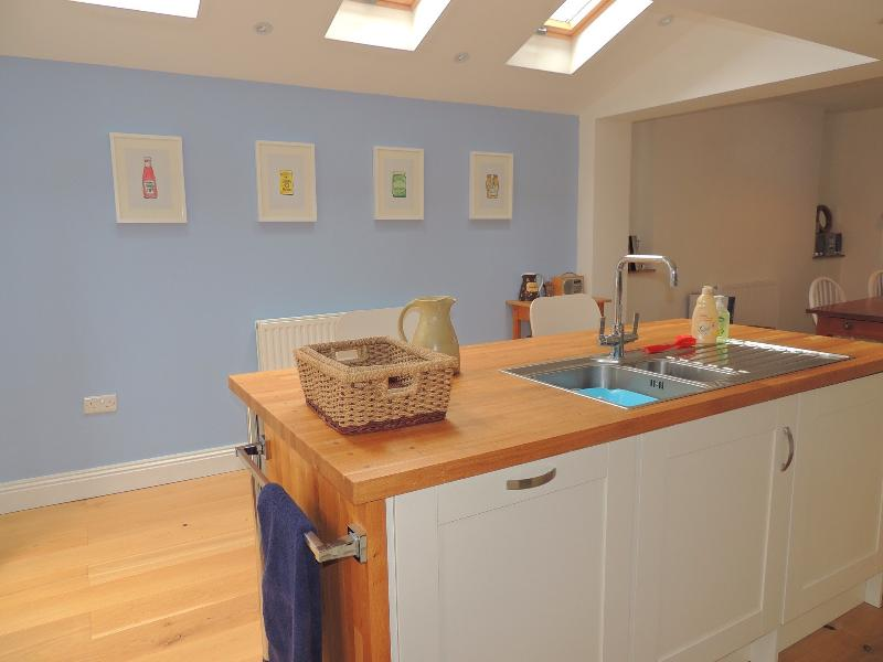 Fully fitted, airy kitchen with island unit