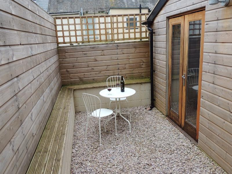 Private enclosed courtyard to the rear of the kitchen