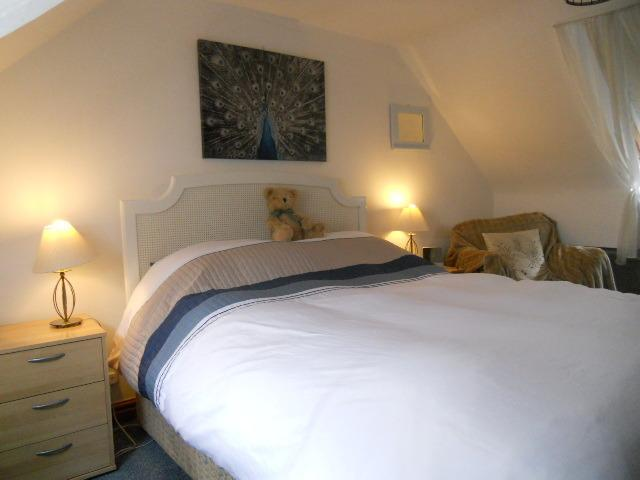 Double bedroom with king size bed and duvet for extra comfort.