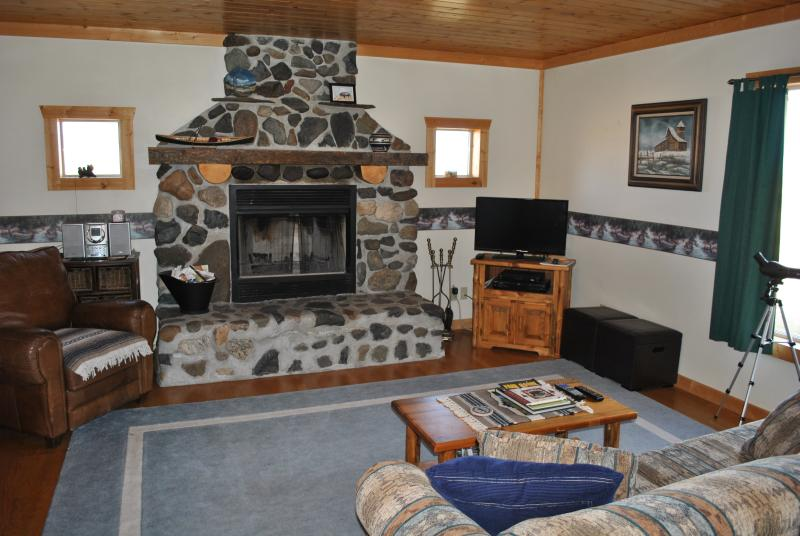 Comfy living room with river rock fireplace as a highlight