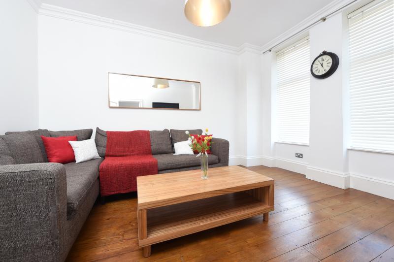 Lounge with corner sofa, coffee table, wall-mounted flat screen TV and WiFi