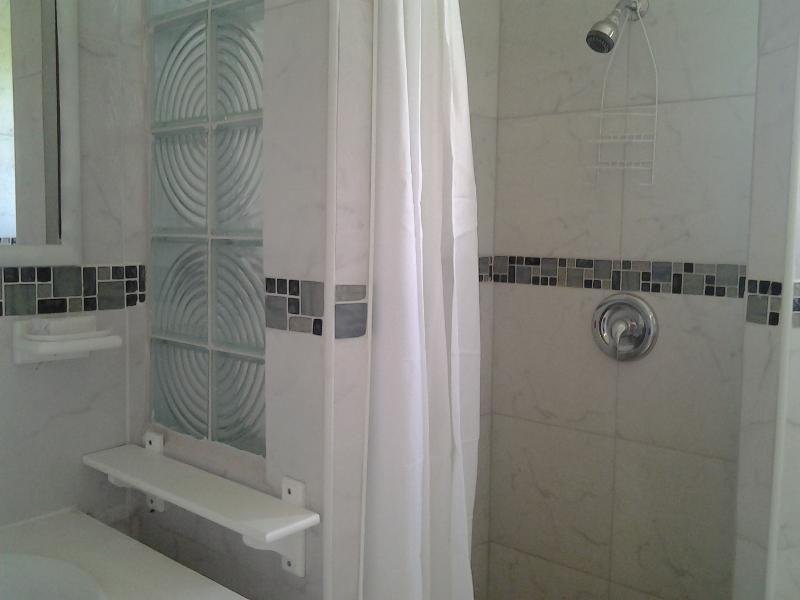 Tastefully finished, clean ensuite bathroom with solar heating