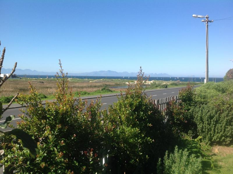 View from front garden to beach, sea and Hottentots Holland mountains beyond