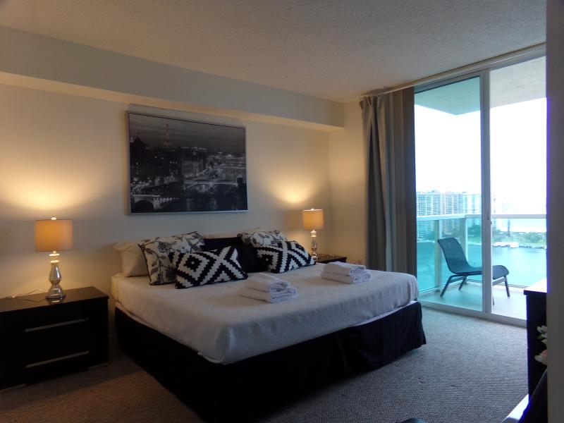 bedroom with king bed and water view