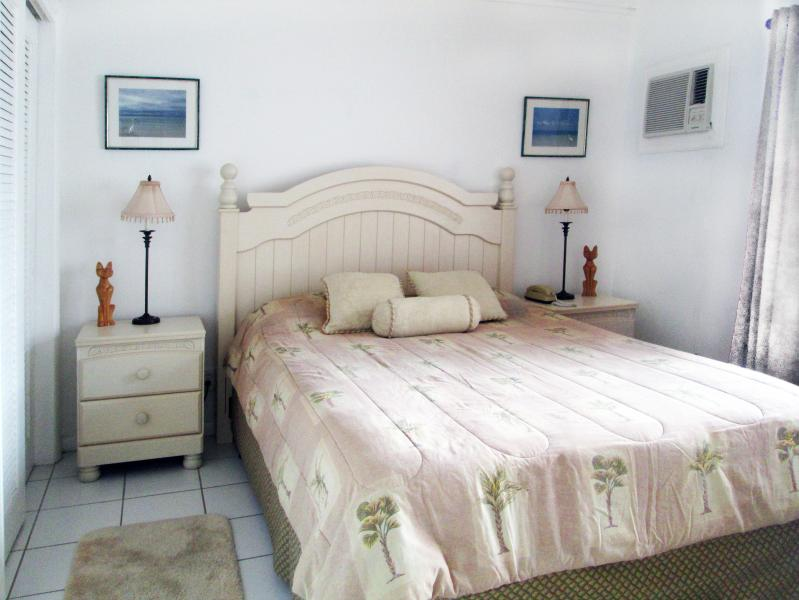 The bedroom is also light and airy