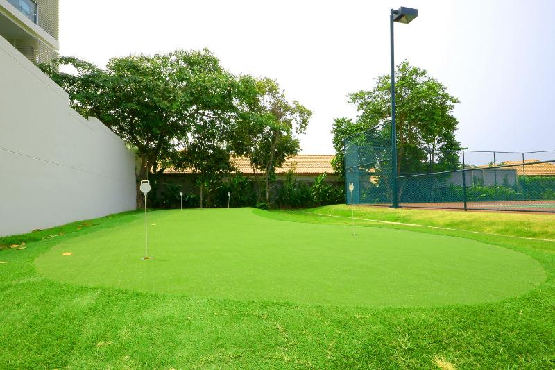 Putting green and tennis courts
