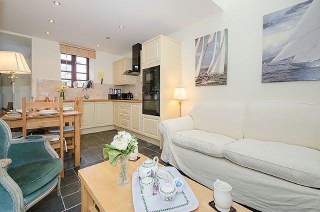 The lovely comfortable open plan kitchen, dining area and sitting room