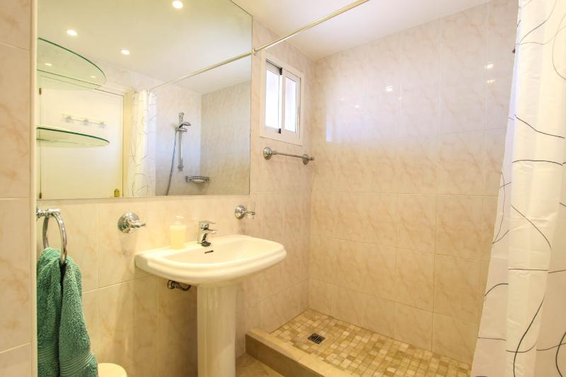 En-suite walk in shower unit small window to balcony and cupboards
