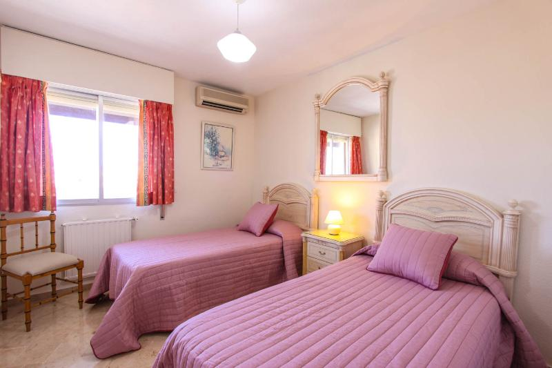 Single beds with window to balcony wardrobes & chests of drawers with A/C