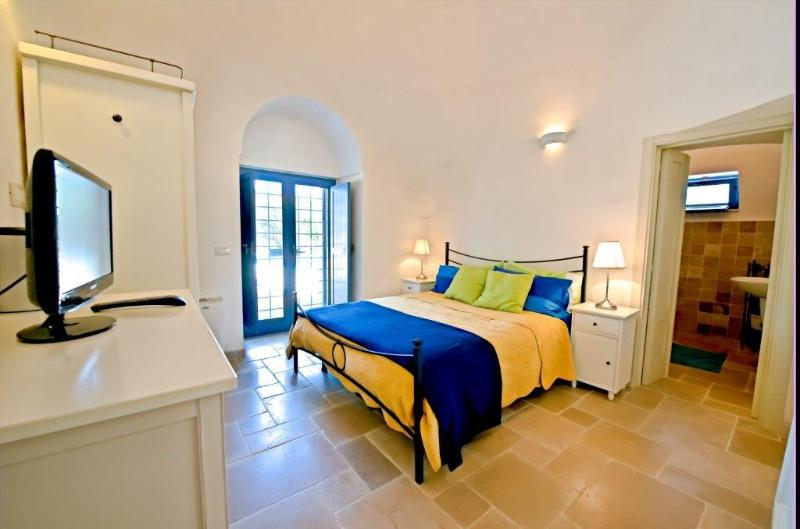 Main Double bedroom with ensuite bathroom and door to pool