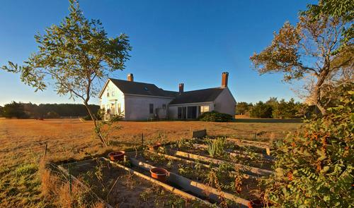 Renovated 1840 farmhouse with family room with 7 sliding doors. Golf cart for access to beach.
