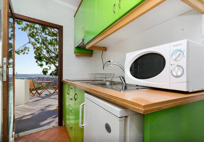 Equipped kitchen with door to private terrace