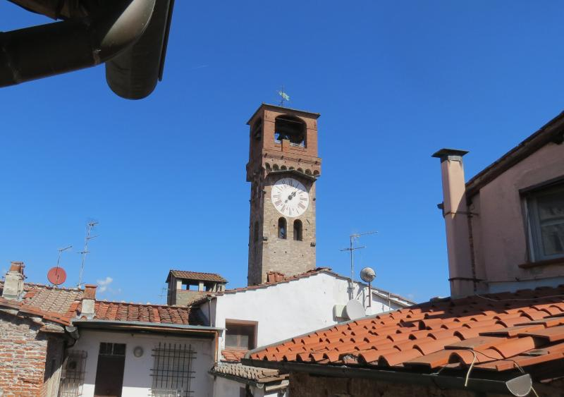 View of the medieval Clock Tower from the tiny sort of dehors next to the bathroom
