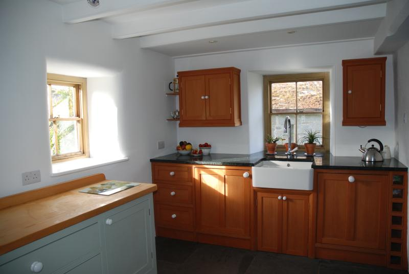 Bespoke kitchen, granite worktops, butlers sink.