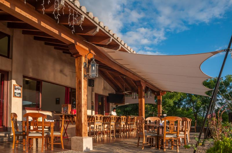 On-site bar and restaurant with happy hour weekdays
