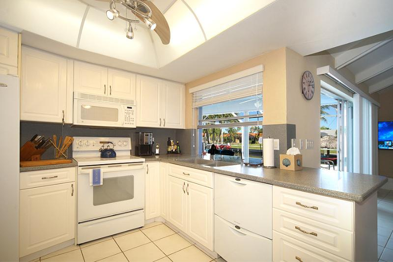 Fully equipped kitchen with pass-thru to the lanai