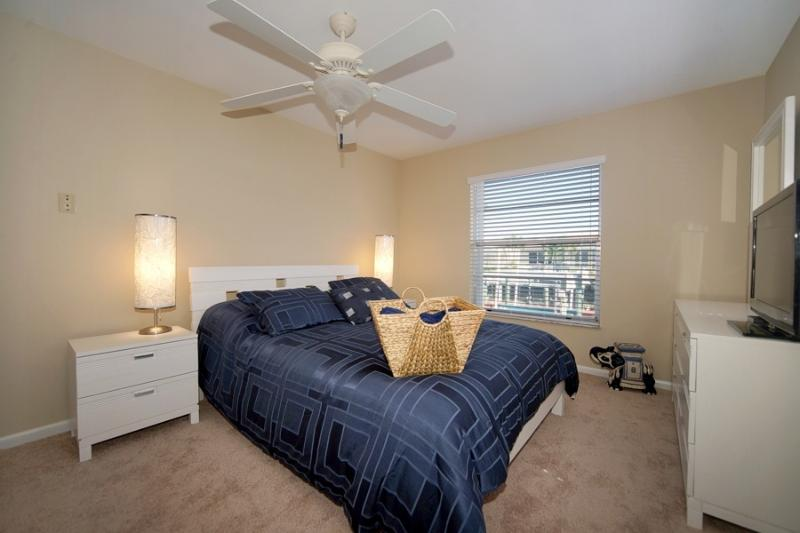 Guest Queen Bedroom with TV, and canal view,and always, a large closet! South Wing