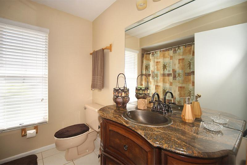 Guest Bathroom, between two guest bedrooms. Shower and Tub. South Wing