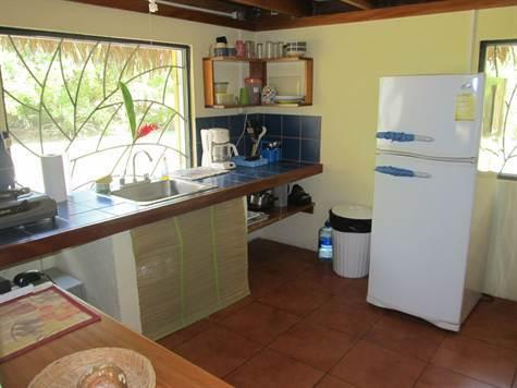 Adjoining Kitchen with full refrigerator, three burner stove, blender and more!