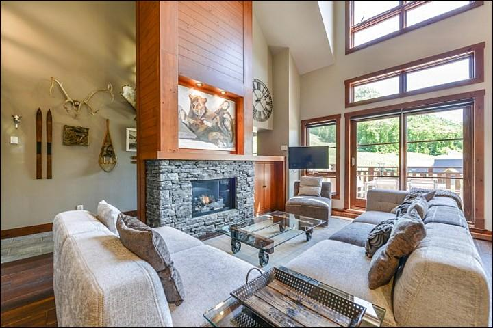 Living Room has Cathedral Ceilings and a Cozy Fireplace