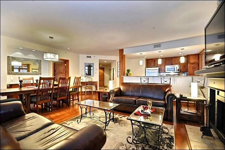 Living Room with Large Flat Screen TV and Fireplace