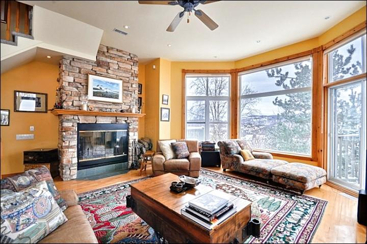 Cheerful Living Room has a Gas Fireplace and Large Windows