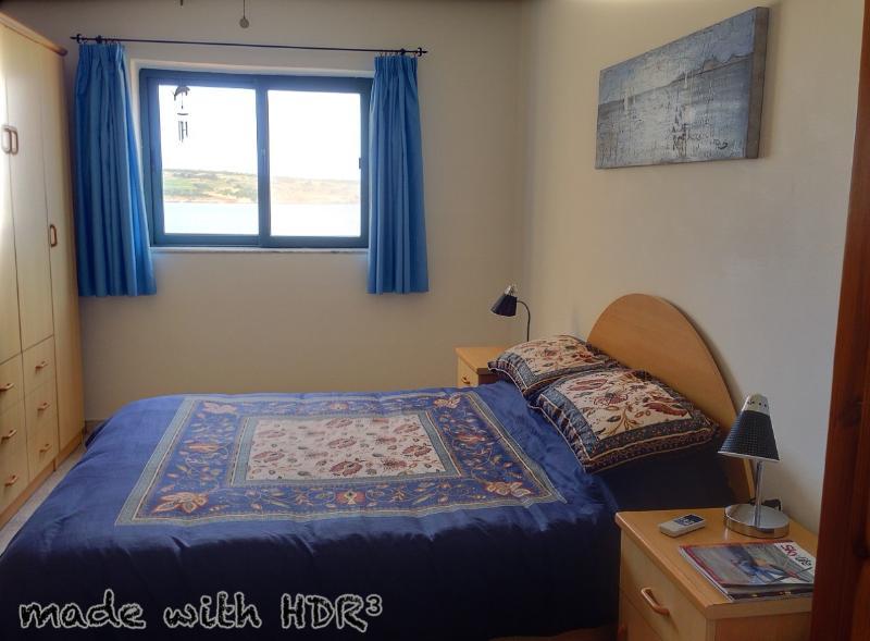 Bedroom 3. Air-conditioned, sea views, en-suite bathroom, king size bed.