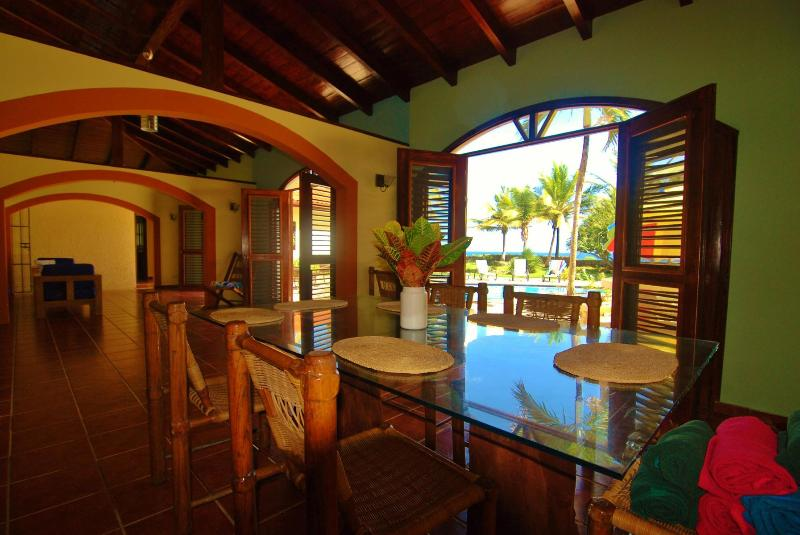 The dining room also opens to the breeze and pool and looks out toward the ocean.