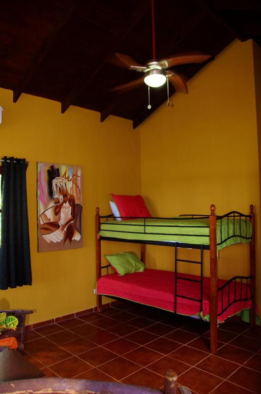 In addition to the queen sized bed in the master bedroom, there are 2 twin beds.