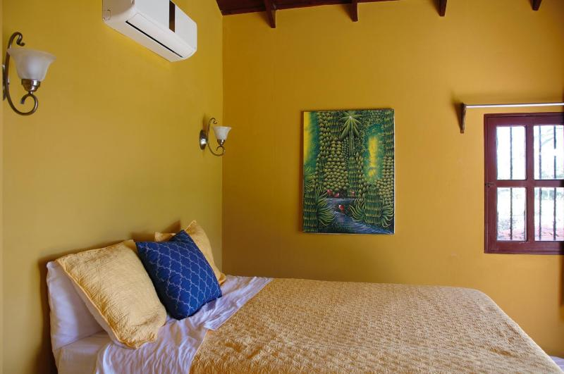 Bedroom 3: Queen sized mattress, great, soft bedding, A/C and opens to the ocean breeze.