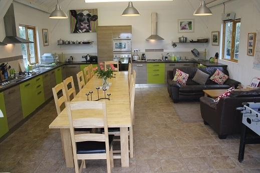 The Cow Shed Kitchen.  Each yurt has its own kitchen area with sink and fridge.  Comfy sofas and