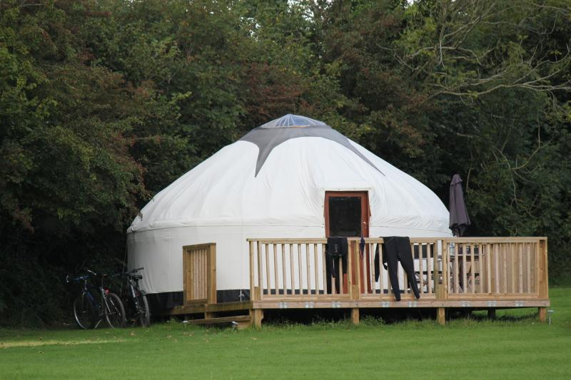 One of our three hand crafted luxury yurts with private deck.