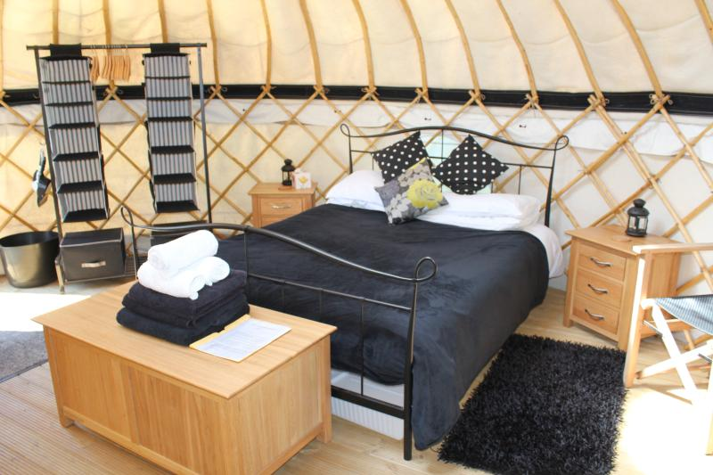 Inside one of our luxury yurts.  King sized beds and contempoary oak furniture and cosy wood burners